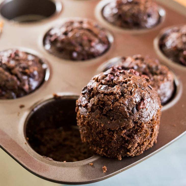 Keto Chocolate Zucchini Muffins Recipe Topped With Cacao Nibs #keto https://ketosummit.com/keto-chocolate-zucchini-muffins-recipe