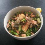 Keto Salmon and Broccoli Saute Recipe Topped with Fried Salmon Skin #keto https://ketosummit.com/keto-salmon-broccoli-saute-recipe
